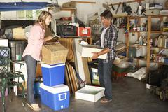 Couple Clearing Garage For Yard Sale - stock photo