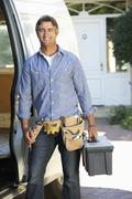 Portrait Of Repairman Arriving In Van - stock photo