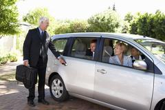 Group Of Business Colleagues Car Pooling Journey Into Work Stock Photos