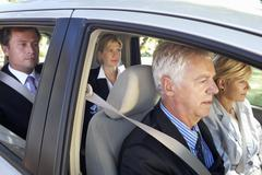 Stock Photo of Group Of Business Colleagues Car Pooling Journey Into Work