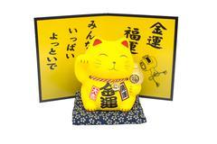 Maneki Neko, Yellow lucky cat isolated on white background - stock photo
