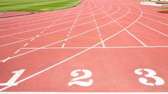 Red treadmill at the stadium with the numbering from one two three - stock photo