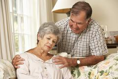 Senior Man Comforting Unhappy Wife At Home Stock Photos