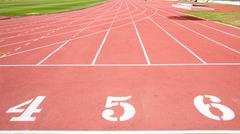 Red treadmill at the stadium with the numbering from fourth five six Stock Photos