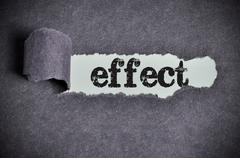 Effect word under torn black sugar paper Stock Photos