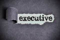 Executive word under torn black sugar paper Stock Photos