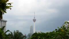 KL Tower and Petronas Twin towers in one frame, telephoto shot Stock Footage