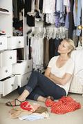 Teenage Girl Choosing Clothes From Wardrobe In Bedroom Stock Photos