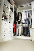 Tidy Teenage Bedroom With Neat Wardrobe Stock Photos