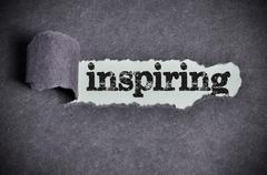 inspiring word under torn black sugar paper - stock photo