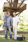 Grandfather, Father And Son Building Tree House Together Stock Photos