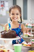 Young Girl Standing By Table Laid With Birthday Party Food Stock Photos