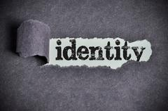Identity word under torn black sugar paper Stock Photos