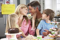 Family Celebrating Father's Homecoming Kuvituskuvat