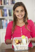 Girl With Healthy Lunchbox In Kitchen Stock Photos