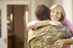 Stock Photo of Soldier Returning Home And Greeted By Wife