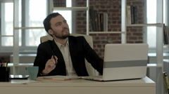 Young businessman sitting in office, search idea Stock Footage