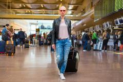 Female traveller walking airport terminal. Stock Photos