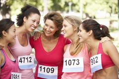 Stock Photo of Group Of Female Athletes Competing In Charity Marathon Race