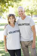 Senior Couple Working As Part Of Volunteer Group - stock photo