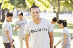 Volunteer Group Clearing Litter In Park - stock photo