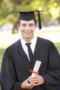 Male Student Attending Graduation Ceremony - stock photo