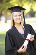 Female Student Attending Graduation Ceremony Stock Photos