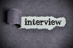 Interview word under torn black sugar paper Stock Photos