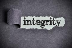 Integrity word under torn black sugar paper Stock Photos