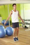 Man Exercising With Skipping Rope In Gym Stock Photos