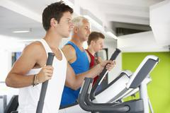Group Of People Using Different Gym Equipment Stock Photos