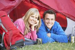 Couple Inside Tent On Camping Holiday Stock Photos