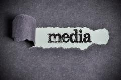 media word under torn black sugar paper - stock photo