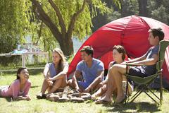 Group Of Young People On Camping Holiday Together Stock Photos