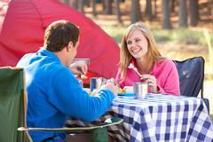 Couple Enjoying Meal On Camping Holiday - stock photo