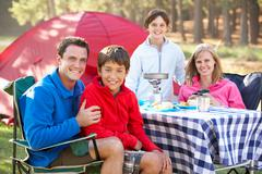 Family Enjoying Meal On Camping Holiday - stock photo