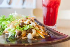 Mushroom salad and roselle water Stock Photos