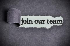 Join our team  word under torn black sugar paper Stock Photos