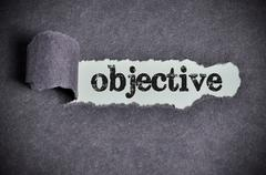 objective word under torn black sugar paper - stock photo