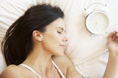 Woman Sleeping In Bed With Alarm Clock Kuvituskuvat