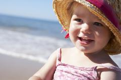Young Girl Playing On Sunny Beach Stock Photos