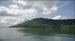 Green island, green sea, blue sky. Stock Footage