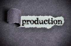 production word under torn black sugar paper - stock photo