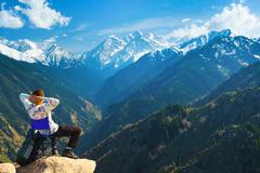 After a long ascent the rest at the top of the mountain. - stock photo