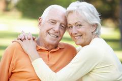 Head And Shoulders Portrait Of Romantic Senior Couple In Park - stock photo