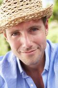 Head And Shoulders Portrait Of Smiling Man With Sun Hat Stock Photos