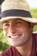 Head And Shoulders Portrait Of Smiling Man With Sun Hat - stock photo