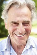 Head And Shoulders Portrait Of Smiling Senior Man Stock Photos