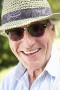 Head And Shoulders Portrait Of Smiling Senior Man With Sun Hat Stock Photos