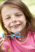 Head And Shoulders Portrait Of Girl Blowing Bubbles Stock Photos
